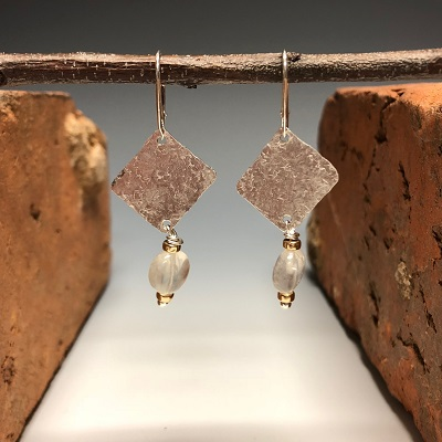 Silver earrings with moonstones